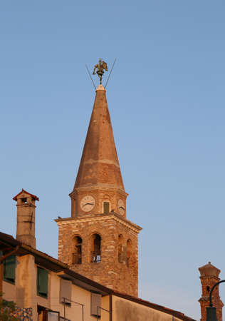 ancient church and bell tower of Santa Eufemia in the city called GRADO in Northern Italy