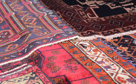 many oriental carpets with geometric colors and designs in woole material Stok Fotoğraf