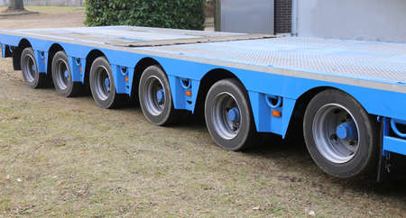 huge truck for transport of heavy goods with two couples of wheels for five axis