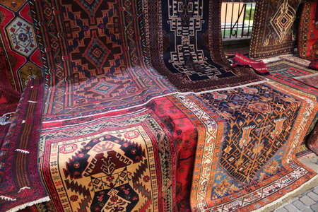 many oriental carpets with geometric colors and designs for sale in the stand Stok Fotoğraf