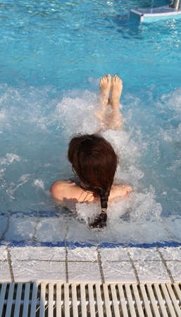 young woman during whirlpool in the pool in a luxurious spa