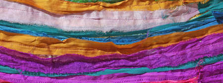 pieces of fabric sewn together photographed with a macro lens to bring out the seams and the textures of fabrics Stock Photo