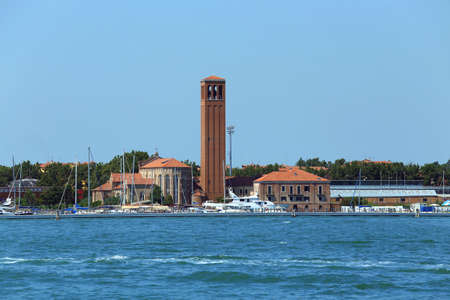 bell tower of Saint Elena Island in Venice in Italy and th boat Stock fotó