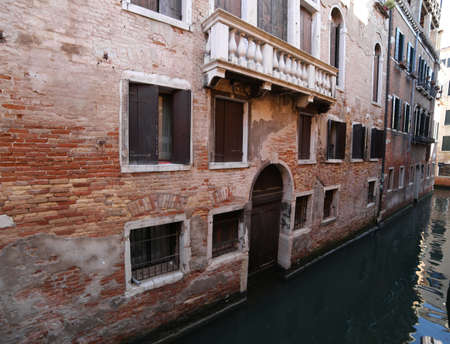 venetian house near the navigable canal in Venice in Italy without boats