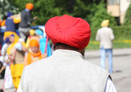 man with the rossoturban during the religious Sikh event on the streets of the city