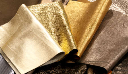 Precious fabrics with golden color of pieces of leather working