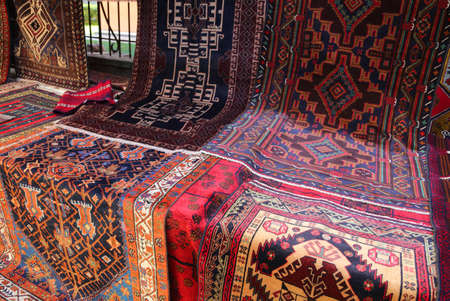 many oriental rugs with geometric colors and designs for sale on the local market
