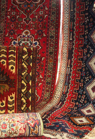 Asian rugs for sale on the stand of an open air market Stok Fotoğraf