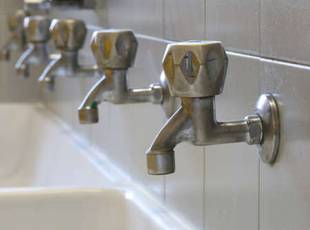 series of many taps in the bathroom in the primary school
