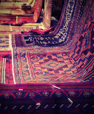many oriental carpets with geometric colors and designs with lomo effect