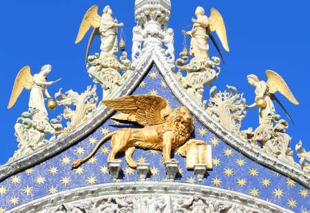 Statue golden winged lion on the Basilica of St. Mark in Venice in Italy Stock Photo
