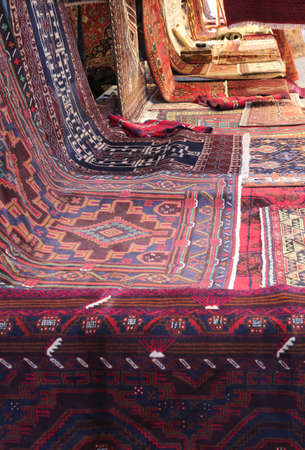 many oriental carpets with different colors and geometric designs