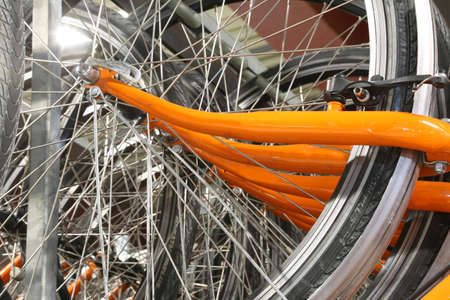 spokes: Series of bicycle spokes in a big parking lot Stock Photo