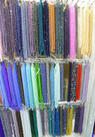many colored pearl necklaces for sale in the jewelery shop Stock Photo