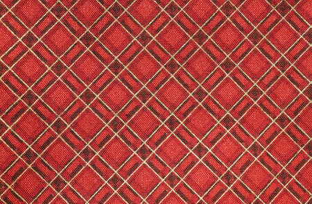 red fabric with colorful Tartan-type Scottish designs