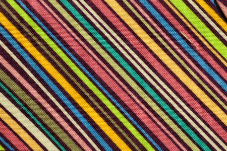 background with oblique colored lines on a cotton fabric Stock Photo