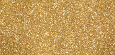 glittery shimmering background perfect as a vivid golden backdrop Stock Photo