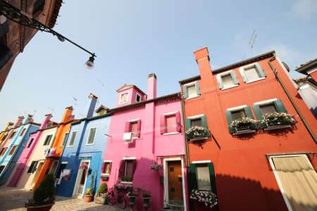 exterior of the colorful houses of the island of Burano near VENICE in Italy