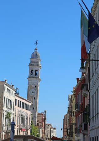 Church and with bell tower called White and leaning bell tower of the church of Saint George of the Greeks in Venice in Italy or  San Giorgio dei Greci in Venice in Nothern ITALY