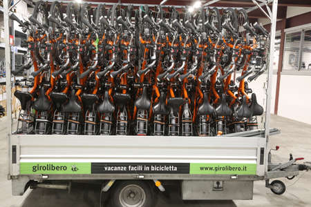 Vicenza, VI, Italy - January 1, 2017: Warehouse of orange bicycles for eco-sustainable tourism in the headquarters of famous tour operator called GiroLibero
