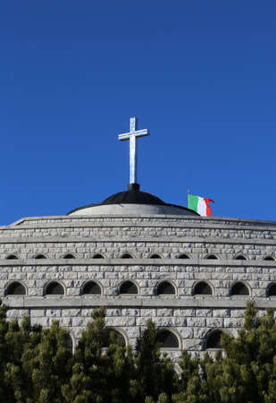 ample: Vicenza, VI, Italy - December 8, 2015: War Memorial of First War World called Ossario del Monte Grappa. Many graves of italian died soldiers and the cross over a small church Editorial
