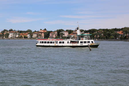 boat sails fast on the Venetian lagoon during transport tourists on the island of Venice in Italy