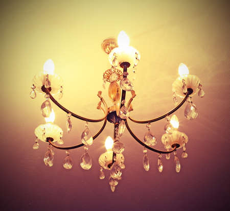 ancient crystal chandelier in a late eighteenth century villa with vintage effect