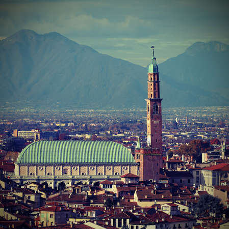 VICENZA city in Northen Italy and the famous monument called BASILICA PALLADIANA and mountains in background with Vintage Effect Banco de Imagens