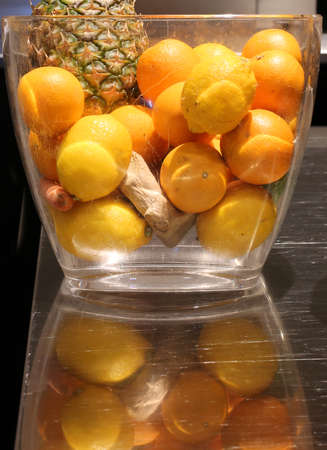 ample: big vase with pineapple lemons and ripe oranges