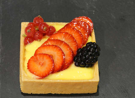 malnutrition: greedy pastry with currant blackberry strawberries in the konditorei