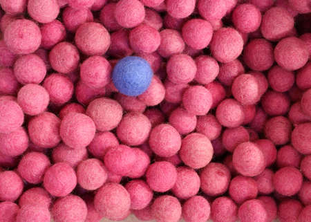 so many pink balls and just a blue ball. Can be used with diversity or discrimination Stock Photo