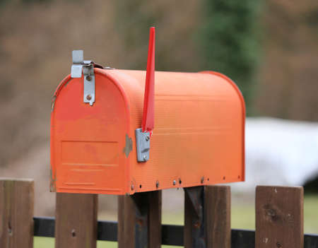 presence: red American style letterbox with the raised rod to signal the presence of mail
