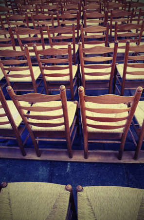background so many wooden chairs in the place of worship before the religious ceremony with vintage effect