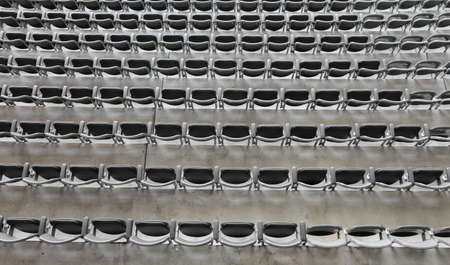gray chairs without the spectators in the big sports facility before the sporting event Stock Photo