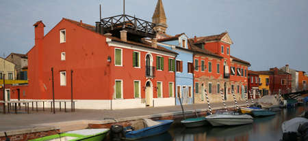 waterway  canal and the colorful houses of the BURANO island near Venice in Italy Imagens