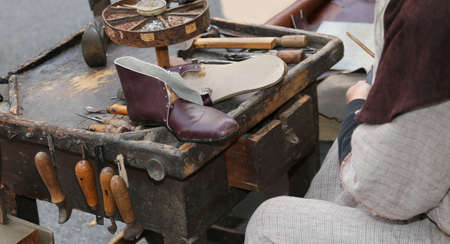 old broken leather shoe in the shoemakers shop