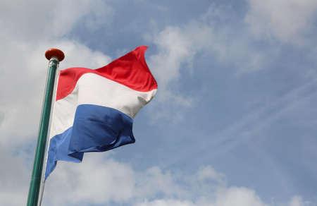 big Dutch flag waving with blue sky