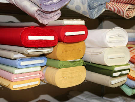 Haberdashery shelves with many types of fabric for sale Stock Photo