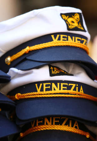 Captain hats of the ship with the Italian text VENEZiA which means VENICE