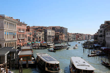 Venezia, VE, Italy - July 14, 2017: Many boat in the Grand Canal and ancient Palaces