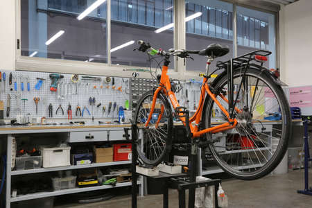 Vicenza, VI, Italy - January 1, 2017: mechanical workshop for bicycle repairs in the headquarters of famous tour operator called GiroLibero 에디토리얼