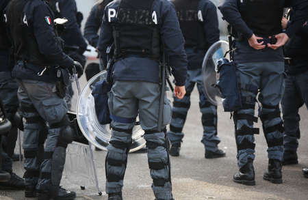 Vicenza, VI, Italy - January 28, 2017: Italian police riot squad with body armor while patrolling the city before the arrival of fans of a football game Sajtókép