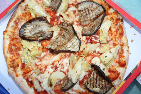 tasty takeaway pizza with eggplant and artichoke Stock Photo
