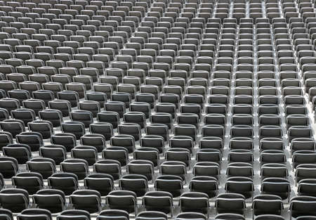 gray chairs without spectators in the sports facility before the sporting event