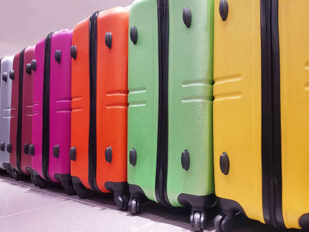 many colorful suitcases awaiting boarding at the international airport Stok Fotoğraf