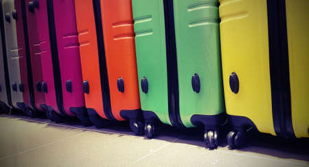 colorful suitcases awaiting boarding at the international airport with vintage effect