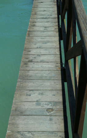 long wooden walkway suspended above the sea Stok Fotoğraf