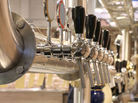 lots of taps to dispense beer in the London pub