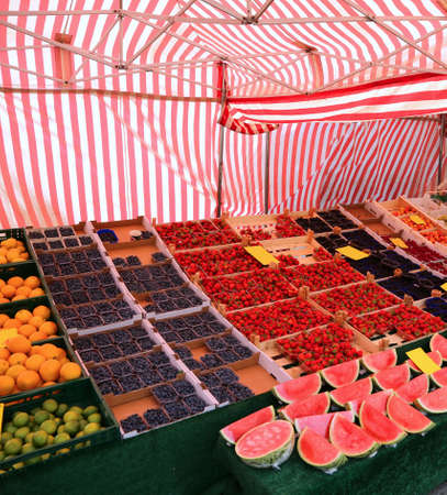 large stall greengrocer with seasonal fresh fruit