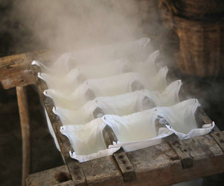 making cheese in a small cheese factory in the mountain hut Stock Photo